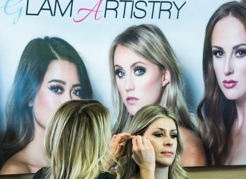 Model Lauren Andrews is tended to by glam artist Aimee Parker during a recent Glam School workshop held at the Best Western in St. Albert.