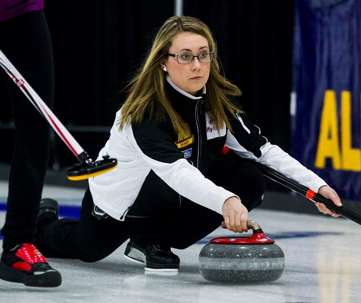 DELIVERER – Karynn Flory of St. Albert looks to make a shot at the Jiffy Lube Alberta Scotties Tournament of Hearts at the St. Albert Curling Club. The Avonair skip is