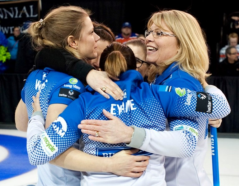 VICTORY HUG – The Shannon Kleibrink rink embrace the moment after defeating Val Sweeting 6-4 in Sunday's final at the Jiffy Lube Alberta Scotties Tournament of Hearts