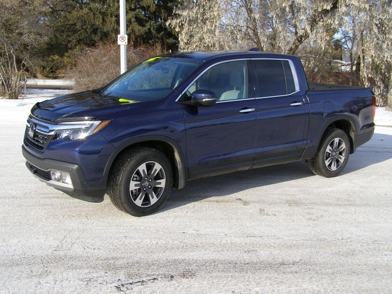 Honda has redone their Ridgeline pickup truck and I'm impressed enough to say I wouldn't mind one in my driveway.