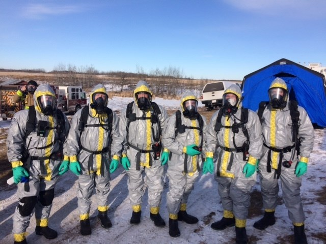 The members of the CLEAR team responding to a call wearing their Level B protection. The suits are totally protective as well but not totally encapsulating. They have an