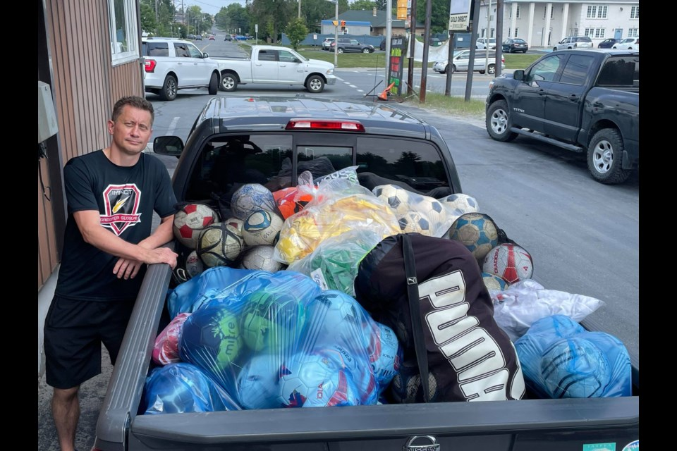 President Joe Snofl loads up donations at GSSC headquarters on Lasalle Boulevard.  These balls, uniforms and equipment will make its way to Zimbabwe by the end of the year.