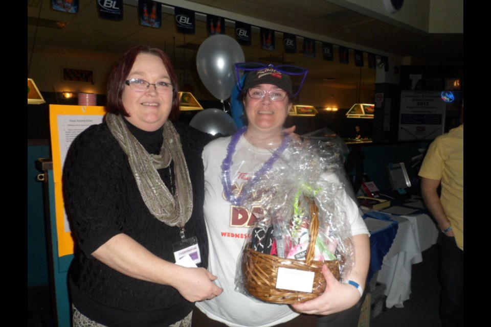 What would a fundraising event be without a door prize?! Here's the winner. Photo supplied