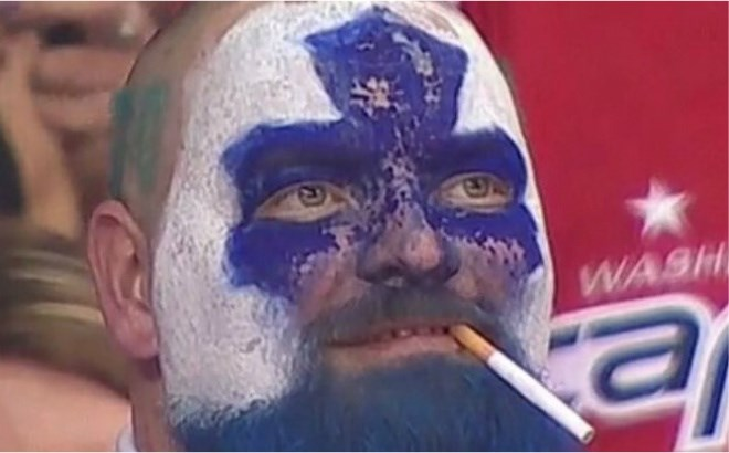 """Jason Maslakow, who was born and raised in Sudbury, is better known on Twitter and other social media as """"Dartguy"""" or """"Dartman."""" Now living in Waterloo, he's having his 15 minutes of fame after his face was shown during the overtime in Washington, an unlit cigarette dangling from his mouth, his face painted white with a blue maple leaf in the centre. (Supplied photos)."""