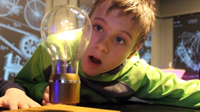 Grade 6 Carl Nesbitt student Emmet Thompson checks out the Flyte Levitating Light which is part of the new 101 Inventions That Changed the World exhibit at Science North. Photo by Heather Green-Oliver