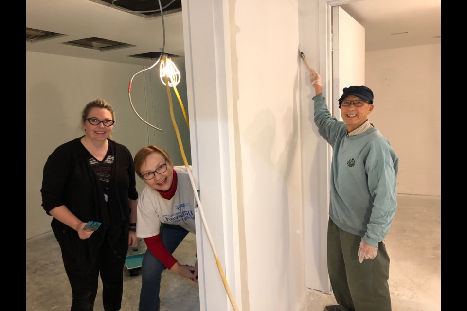 Becky Bose, Susan Bruce and Raymond Pong do some painting at Sudbury Indie Cinema's new theatre. (Supplied)