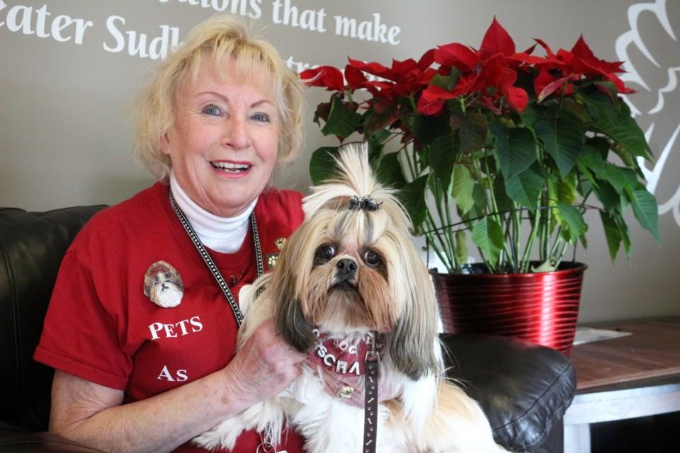 Rita Terry, coordinator of Pets as Therapy volunteer group, with her dog Porscha. (Keira Ferguson/ Sudbury.com)
