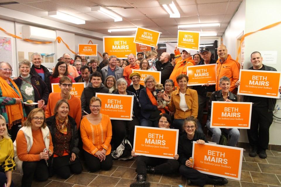 A group poses at Sudbury NDP candidate Beth Mairs' UpRiSingh event Oct. 16. (Matt Durnan/Sudbury.com)