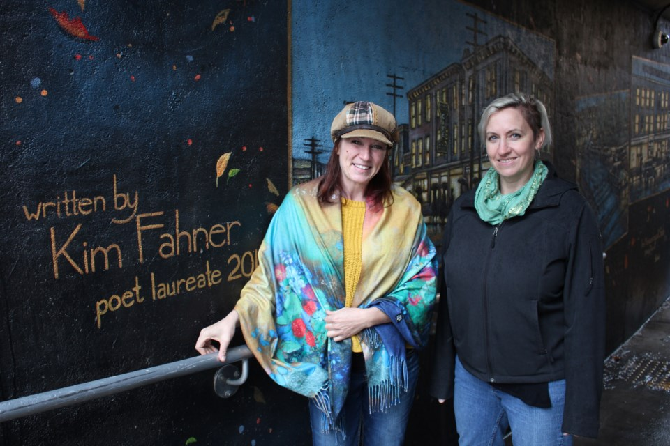Monique Legault and Evelyn Eekels with their new mural on the Elgin Street ramp leading into the Elgin-Riverside pedestrian underpass. (Heidi Ulrichsen/Sudbury.com)
