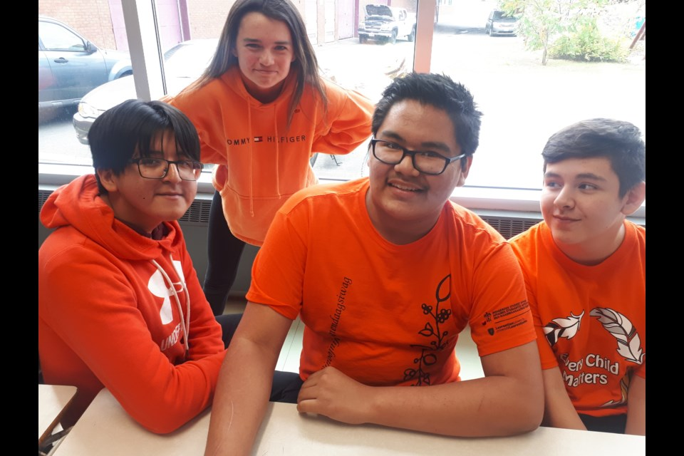 These students at St. Charles College took part in Orange Shirt Day Sept. 30. From left are Avery Ense, Paige Robinson, Sterling Owel and Payton Bob. (Supplied/Anastasia Rioux)