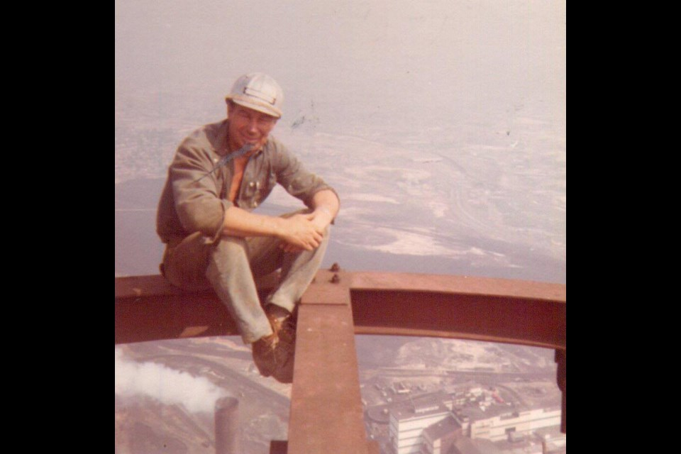 Aarne Kovala is seen here sitting on the top of the Superstack, which he helped to build in the 1970s. (Supplied)