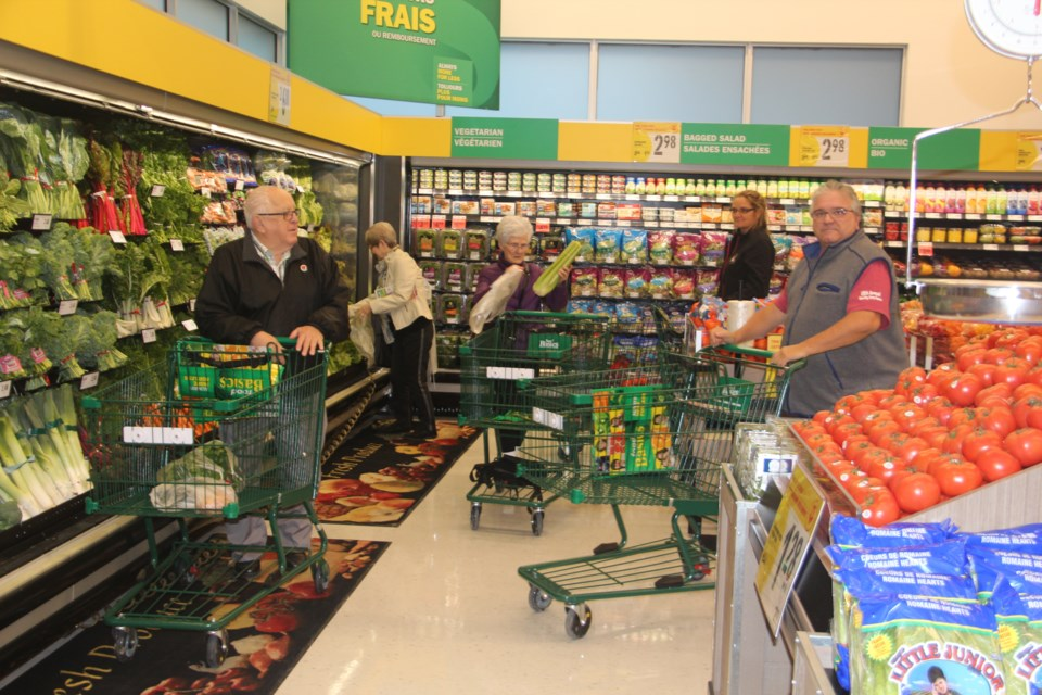 Shoppers check out the new Chelmsford Food Basics Thursday morning. (Heidi Ulrichsen/Sudbury.com)