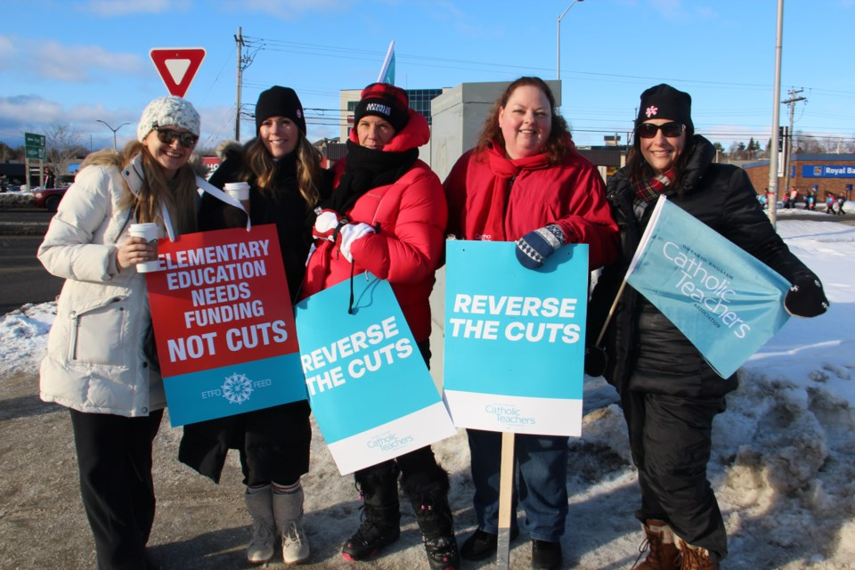 Members of the Elementary Teachers' Federation of Ontario (ETFO) and the Ontario English Catholic Teachers' Federation (OECTA) pose together at the Four Corners in Sudbury Tuesday morning as both unions hit the picket lines together. (Heidi Ulrichsen/Sudbury.com)