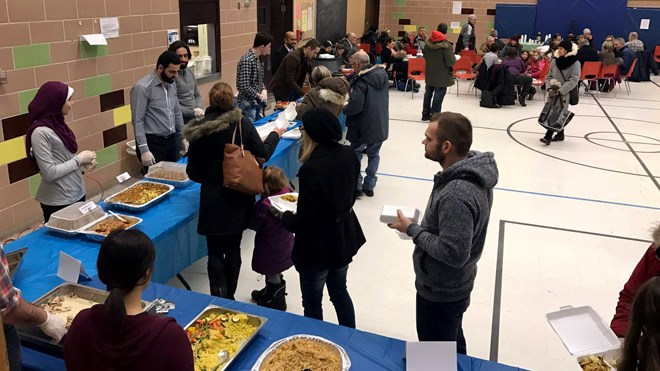 They were lining up outside the door at Lansdowne Public School on Saturday afternoon to get a taste of kibbe and a host of other Middle Eastern food. Photo: Sudbury Muslim Society/Facebook
