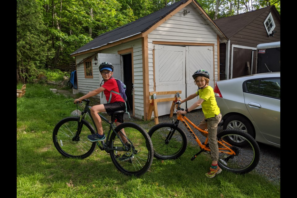 Clark and Emmerich MacIntyre, aged 9 and 12, with the new bikes they helped buy with their allowance money.  They really enjoy riding their bikes to go to the park, take family bike trips, or even zipping downtown for an orthodontics appointment. (Supplied)