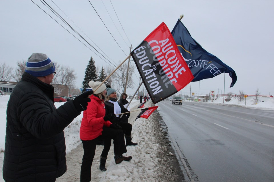 Members of the Ontario Secondary School Teachers' Federation are seen on the picket lines in December. (File)