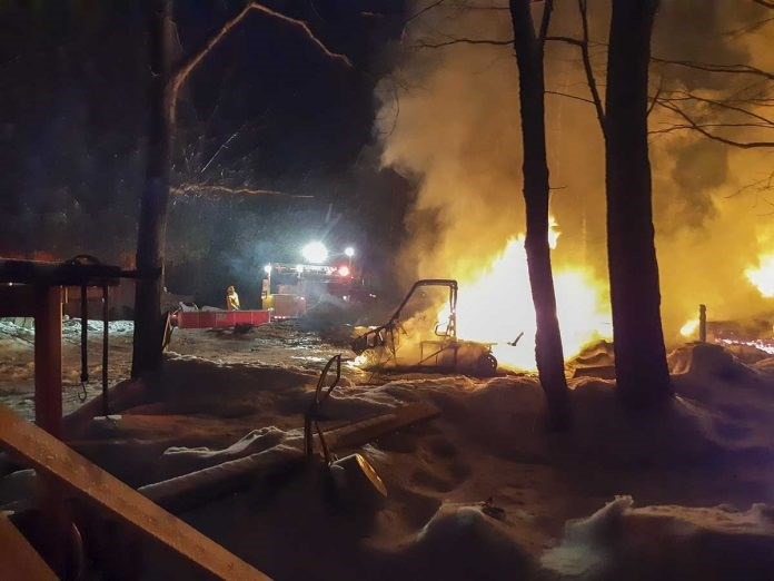 A Robinson Township man has been arrested and charged with arson in relation to three fires that occurred last Friday evening and in September 2019, including this house fire in Robinson Township and a second in Gordon township. (Photo Colin Frame)