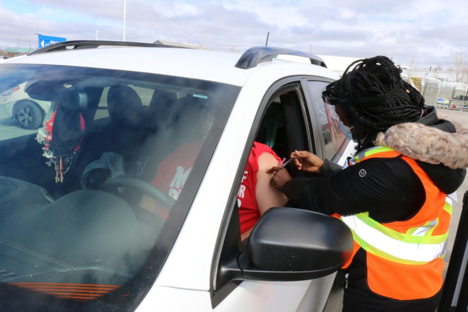 Registered Practical Nurse Michele Leblond administers a Moderna COVID-19 vaccine to Paul Perron of Capreol, one of the hundreds of Sudbury area residents who took part in Sudbury's first ever drive-through vaccination event held at the parking lot of the Real Canadian Superstore on Lasalle Boulevard.