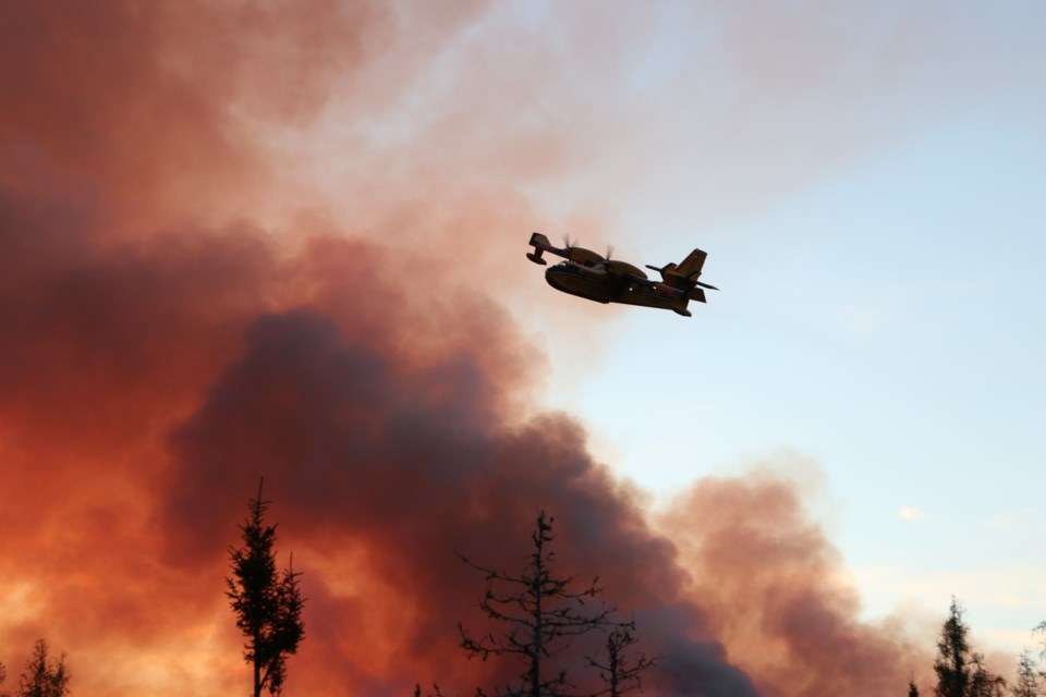 Fire crews with the Minsitry of Natural Resources and Forestry aggressively attack the Timmins 2 fire, burning four kilometres from Gogama. (Supplied)