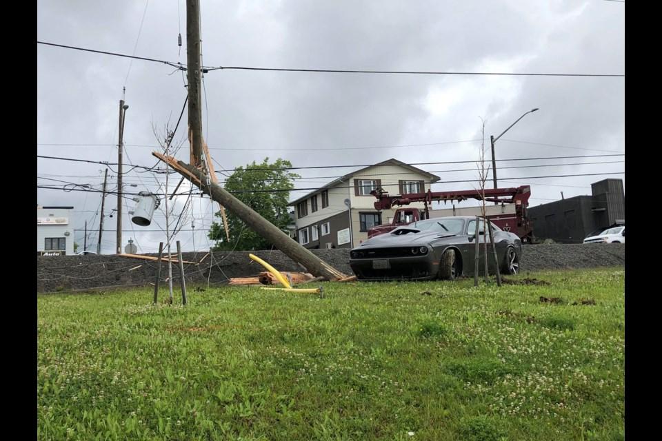 A vehicle crashed into a hydro pole alongside Lorne Street Thursday morning. (Heather Green-Oliver/Sudbury.com)