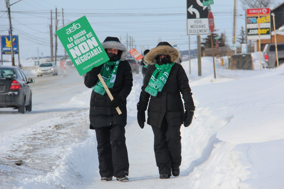 Association des Enseignantes et des Enseignants Franco-Ontariens (AEFO) members on the picket lines at the intersection of Lasalle and Falconbridge Feb. 13. (Heidi Ulrichsen/Sudbury.com)