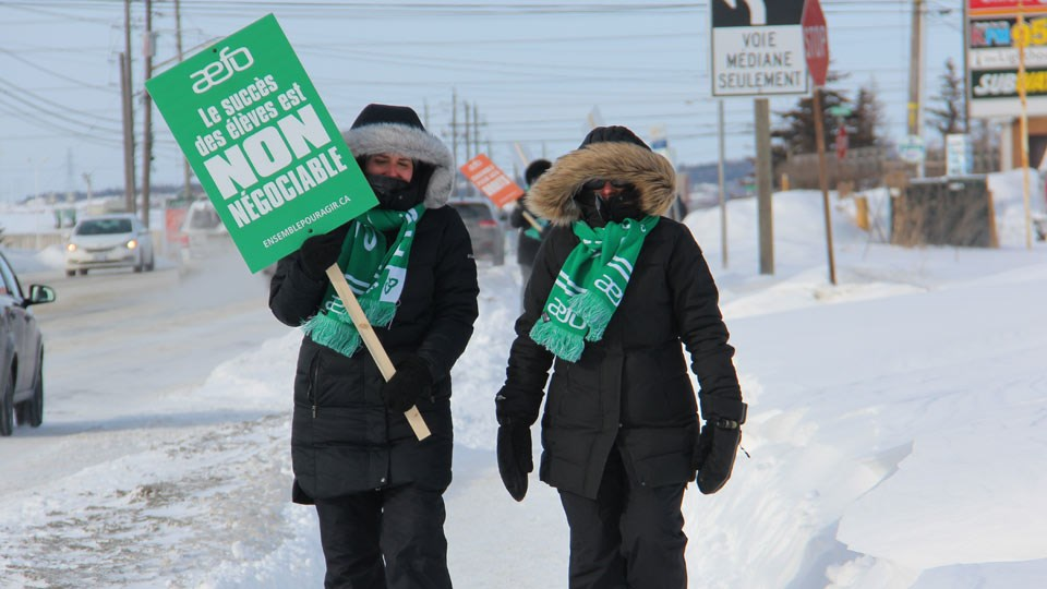 Members of the Association des enseignantes et des enseignants franco-ontariens (AEFO) are seen on the picket lines in Sudbury Feb. 13. AEFO and three other teachers' unions will hit the picket lines provincewide once again Friday, Feb. 21. All four local school boards have cancelled classes that day.  (Heidi Ulrichsen / Sudbury.com)