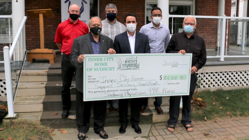 Sudbury physicians have provided a cash donation of $101,428 to Inner-City Home of Sudbury to keep that relief agency operating. Those on hand for Thursday's presentation included, front row left, Inner City board president Joe Drago, physician Dr. Stephen Morris, and board member Dr. Moe St. Marten. Back row from left were board member Jesse Winters, board vice-president Julio Navarro and physician Dr. Bhanu Nalla.