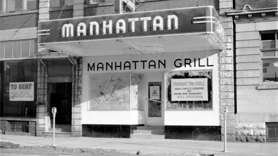 The Manhattan Gill at 12 Cedar St. in the summer of 1941. The Manhattan was under the management of James Ing and Harry Chong. They specialized in Chinese dinners and Sunday meals, served day and night. Also visible in this photo is Sudbury's new parking meters. On Aug. 15, 1940, Sudbury became the first Canadian city to install parking meters (287 meters in total). The purpose of the meter was to encourage people who worked downtown to commute using public transit.
