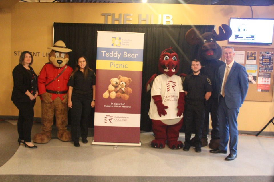 Pictured are Sally Dunton, Community Fundraising Specialist, Canadian Cancer Society, Sudbury and District; The RCMP Safety Bear; Lara Renzetti, Police Foundations student, Burnie the Cambrian College mascot; Austin Clark, Police Foundations student; Inspector Moosseau, Greater Sudbury Police mascot; Bill Best, President, Cambrian College. (Heidi Ulrichsen/Sudbury.com)