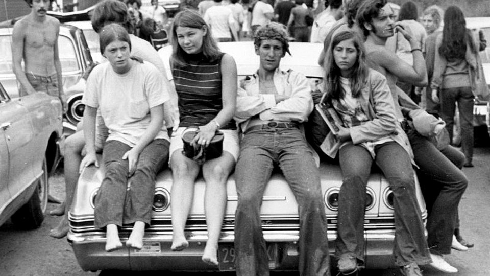 Hippies lounging on a car near the Woodstock music festival on Aug. 18, 1969.