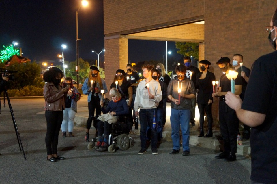 Following a viewing party and Q&A session on Tuesday night, Black Lives Matter Sudbury members and supporters hold a candlelight vigil outside Sudbury Theatre Centre. (Jenny Lamothe/Sudbury.com)