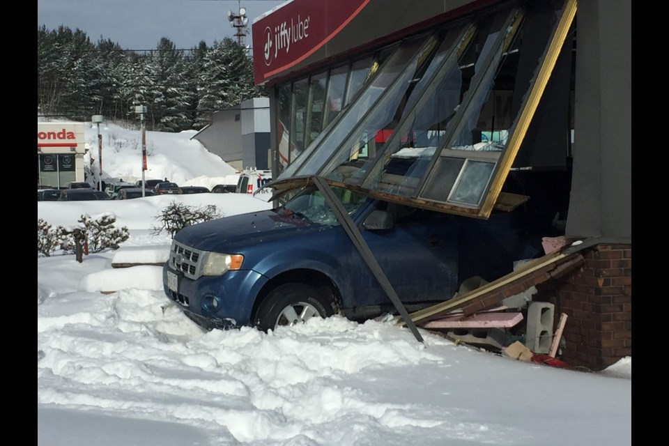 This was the scene at Jiffy Lube on The Kingsway after an SUV crashed through the building Thursday afternoon. (Heather Green-Oliver/Sudbury.com)