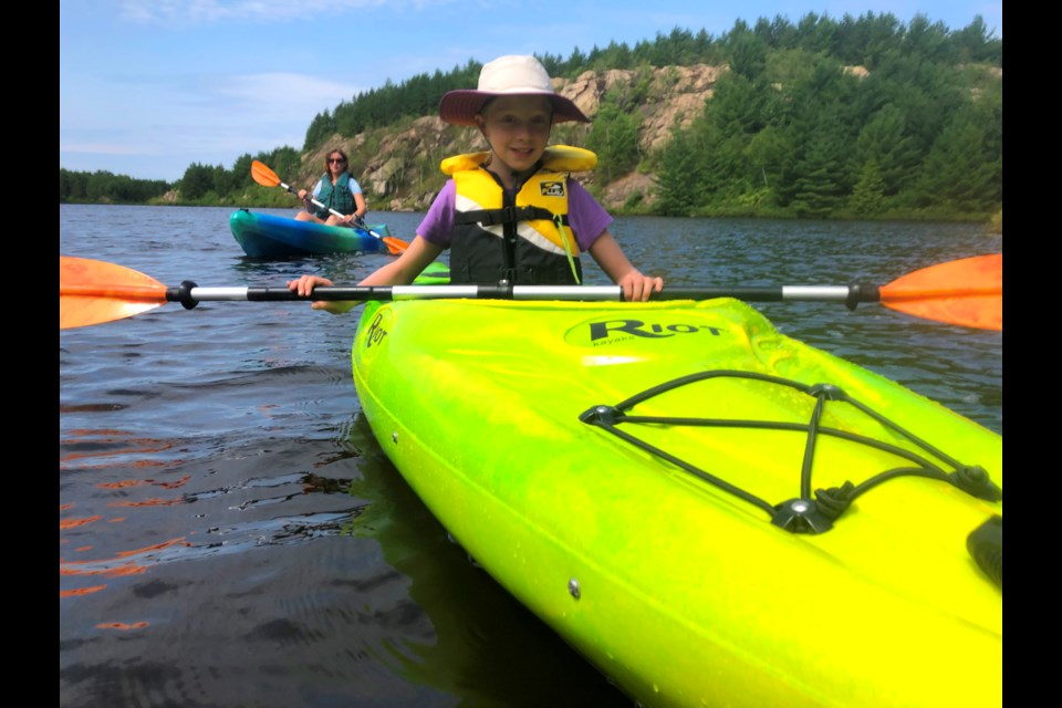 Niko Trudel, 9, was one of the first campers to try out the new fleet of kayaks at Camp Bitobig located at the Lake Laurentian Conservation Area. (Heather Green-Oliver/Sudbury.com)