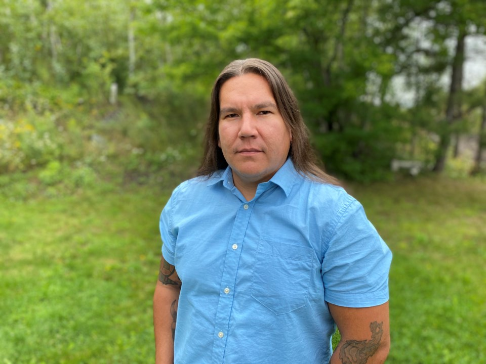 240920_reclaiming-indigenous-hair-Sarah-Rice-braiding-sons-hair-Waubgeshig-Rice