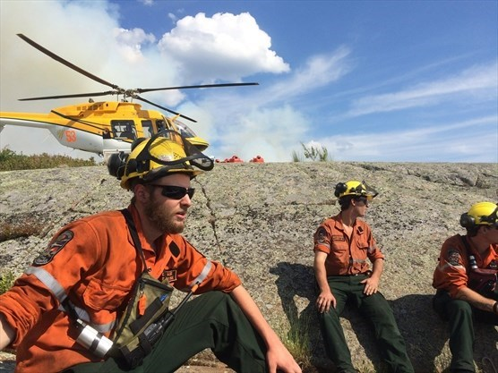 Ministry of Natural Resources and Forestry Fire Rangers take a breather during fire suppression in the French River area. (Shawn Rae photo)