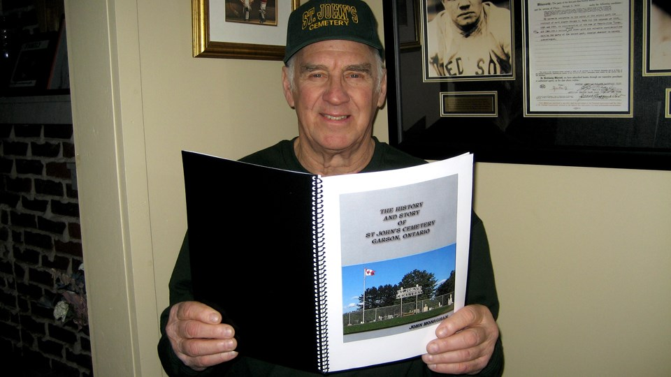 John Monaghan holds a copy of a publication that is close to his heart, The History and Story of St. John's Cemetery, a book he authored in 2017 to archive the stories, events, photos and anecdotes of Garson's beautiful cemetery. (Imiage: Marlene Holkko Moore)