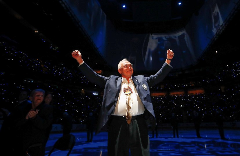George Armstrong raises his hands in the air on Oct. 15, 2016, the night the Toronto Maple Leafs retired his number.