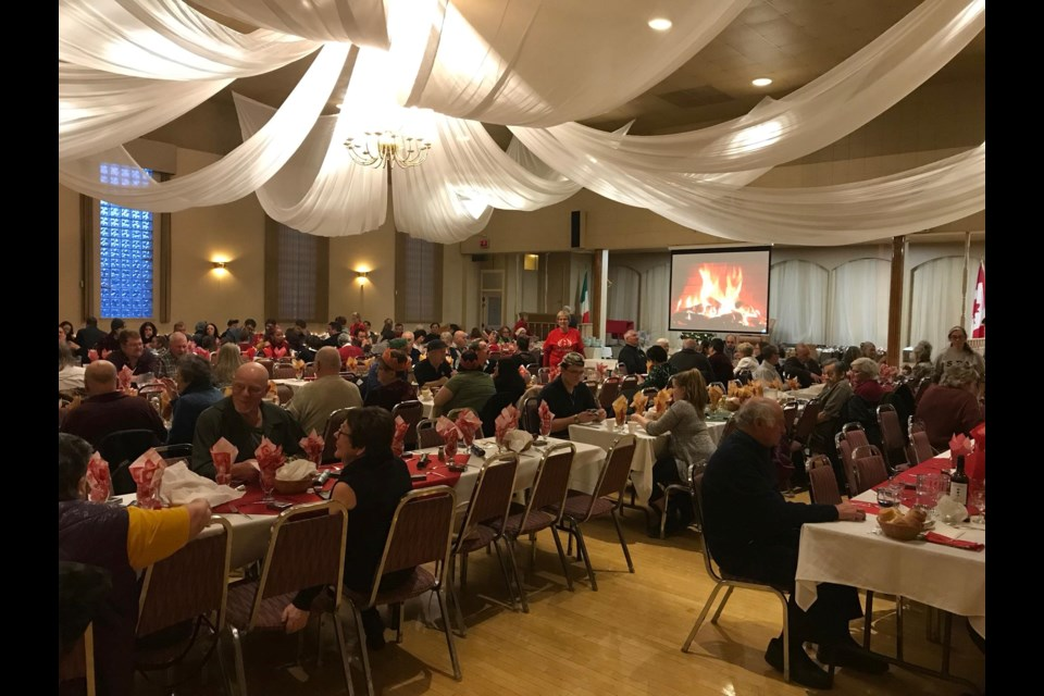 A view of the crowd at the No One East Alone dinner at the Copper Cliff Italian Club on Christmas Day. (Facebook)