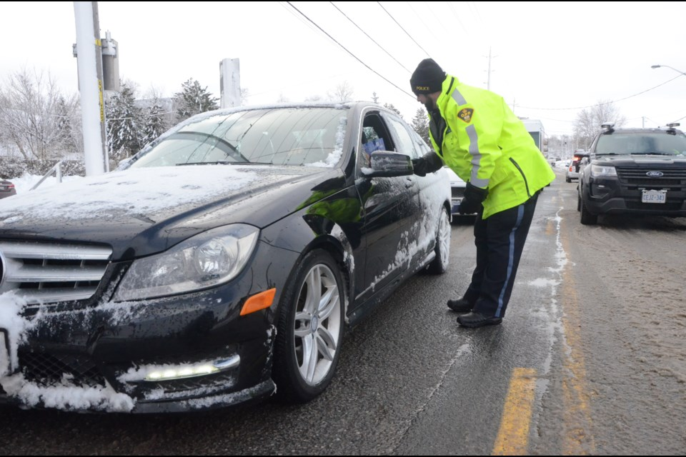 Greater Sudbury Police Service and the Ontario Provincial Police were joined by volunteers with Action Sudbury, Safe Ride Home Sudbury, MADD Canada and Canadian Blood Services to kick off the Festive RIDE campaign, which begins Dec. 1 and carries through until Dec. 31. (Arron Pickard/Sudbury.com)