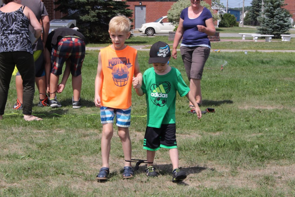On Sunday Capreol's Centennial Field hosted a Family Fun Day and BBQ, that included classic games like a three-legged race, water balloon relay and a bean bag toss. Photo by Jonathan Migneault.