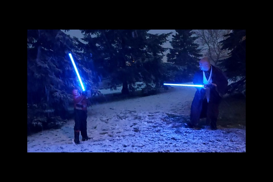 """We had a light saber duel in the snow. Power Ranger vs. Jedi,"" said Hughie David Jeanveau. (Supplied/Hughie David Jeanveau)"