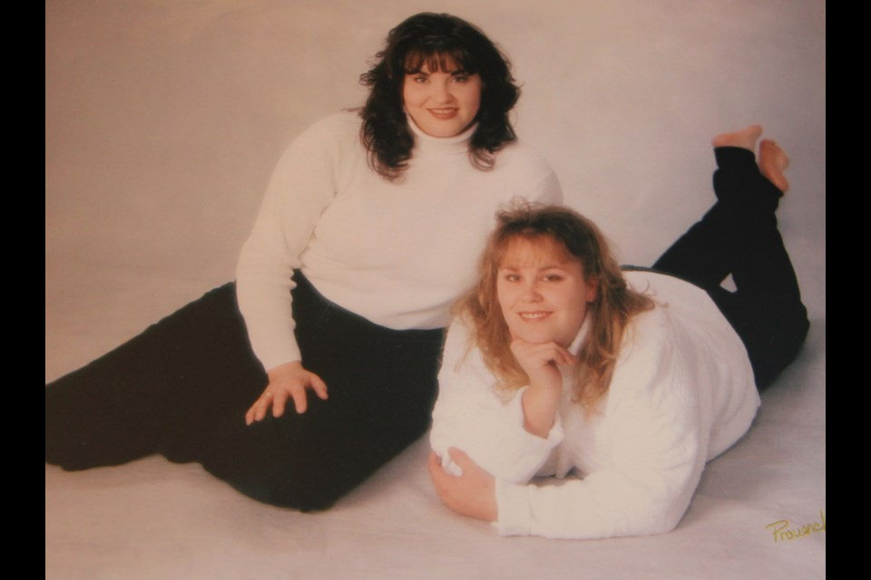Renée and Kim Sweeney had these studio photos taken a few months before her murder 20 years ago. (Supplied)