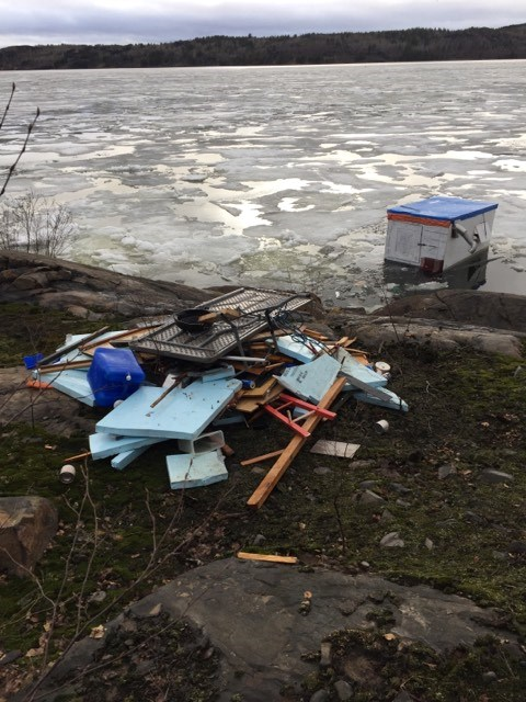 "Collin Waters took this photo of the ice hut in question. He said he tried to remove the ice hut from Kelly Lake April 23. ""It is a 10x10 utility trailer,"" Waters said in an email. ""This is all we got out of the water."" He said he'll be returning until he can get all of the rubbish out of the lake to avoid water contamination. (Supplied)"