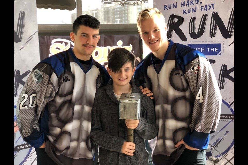 Sudbury Wolves co-captains Shane Bultika (left) and Macauley Carson show off this year's superhero jerseys with help from 11-year-old Children Wish Foundation beneficiary Preston Walker. The Wolves will don Thor themed jerseys during this year's Superhero Game when the Oshawa Generals come to the Sudbury Arena on Nov. 15. This year's superhero game is in support of the Children's Wish Foundation.