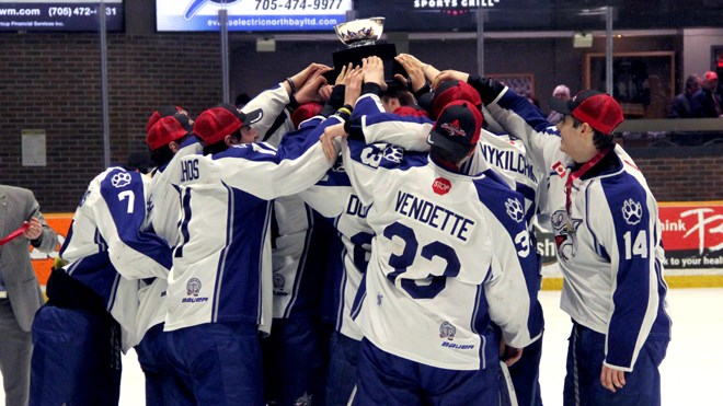 The Nickel Capital Wolves hoist the Great North Midget League trophy after coming from behind to defeat the North Bay Trappers on March 22 in North Bay. (Chris Dawson / BayToday)