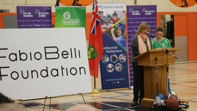 Fabio Belli's wife, Susan, and daughter Emma speak at Thursday's ceremony at Lasalle Secondary. (Darren MacDonald photo)