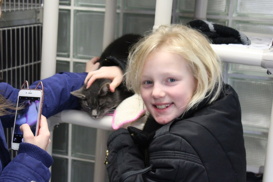 Breeanna Steich (right) with guardian Mya Rams, at the Sudbury SPCA National Cupcake  Day party (Keira Ferguson/ Sudbury.com)