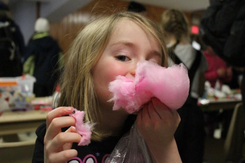 Daughter of Marc Lanteigne, Indie, enjoying her cotton candy at the third annual Family Fun Day (Keira Ferguson/ Sudbury.com)
