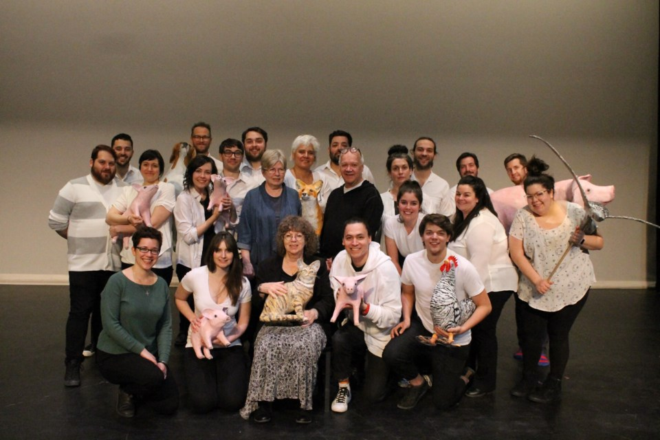 Playwright Colleen Murphy (front centre), director Brian Dooley, and cast and crew pose for a group shot.