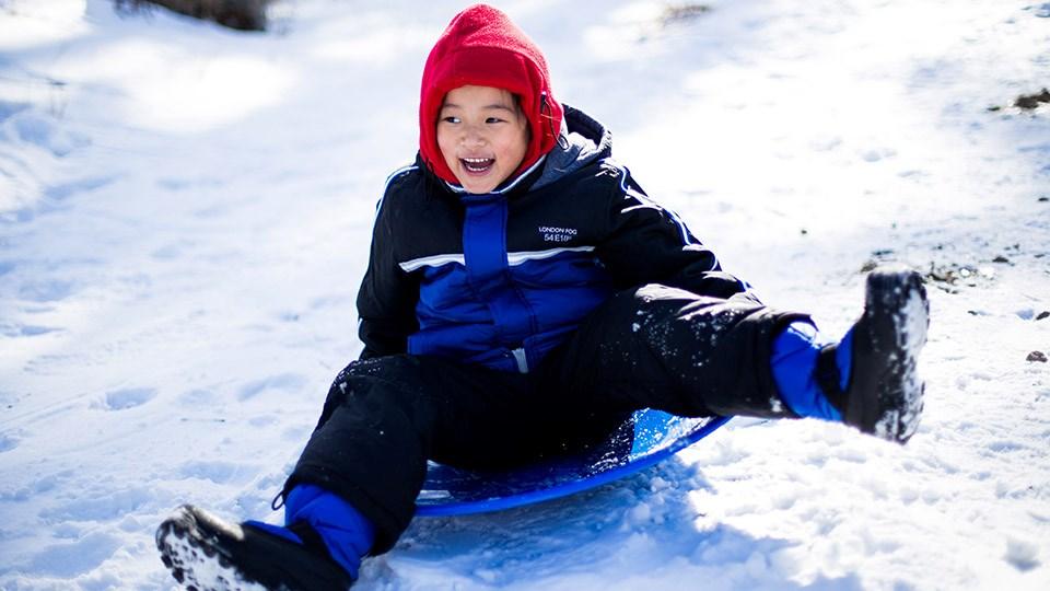 150320_KF_kid_sledding_sized